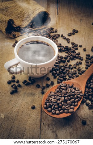cup of hot coffee on the wood desk vintage color - stock photo