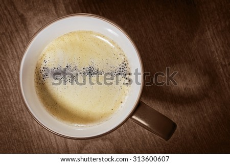 Cup of hot Coffee. Top view on dark wooden table background. - stock photo