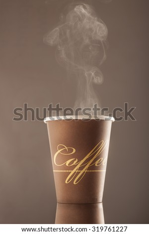 cup of hot coffee with smoke - stock photo