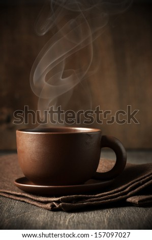 Cup of hot coffee with stem on wooden background. - stock photo
