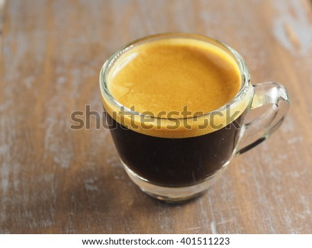 Cup of hot espresso coffee on wood table, background - stock photo