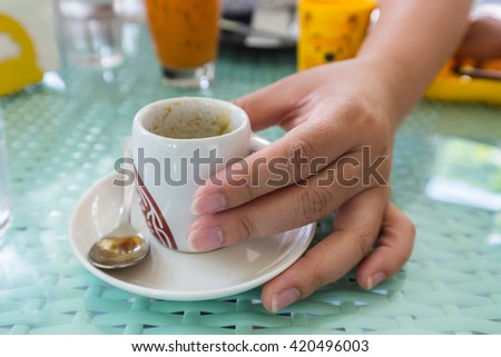 cup of hot espresso coffee shot on glass table - stock photo