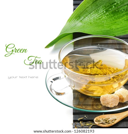 Cup of hot green tea isolated over white - stock photo
