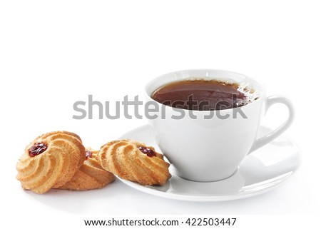 Cup of hot tea and homemade cookies - stock photo