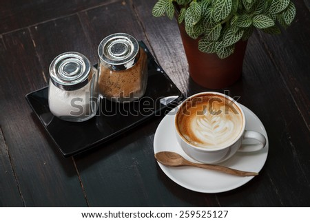 Cup of latte coffee on wooden table