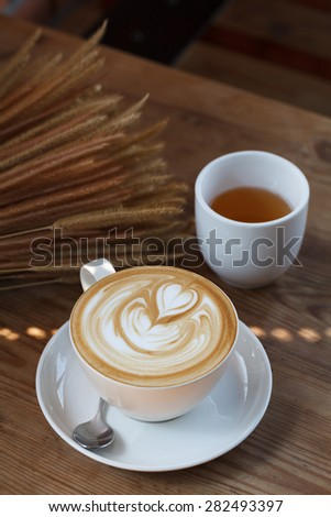 Cup of latte coffee with tea - stock photo