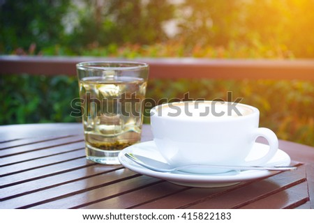 cup of latte, cup of coffee, cup of coffee on brown wooden table - stock photo