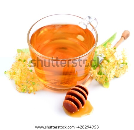 Cup of linden tea with flowers and honey isolated on white - stock photo