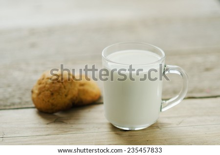 cup of milk with oatmeal cookies - stock photo