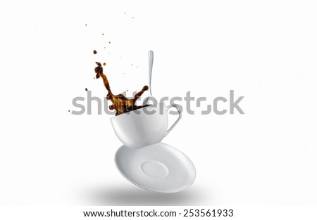 Cup of Spilling black Coffee Creating a Splash - stock photo