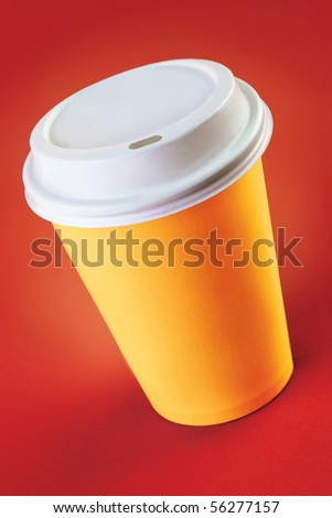 Cup of take-out coffee on a red background - stock photo