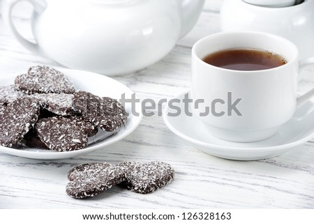 Cup of tea and chocolate cookies in the form of heart - stock photo