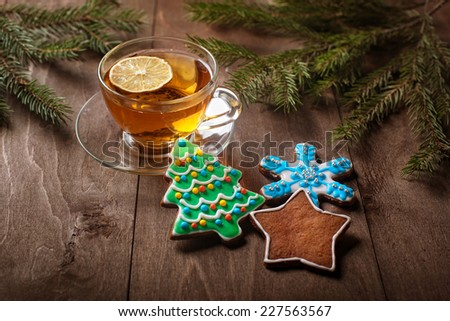 cup of tea and Christmas cakes on a wooden table - stock photo