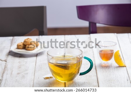 Cup of tea and cookie on a wooden background - stock photo