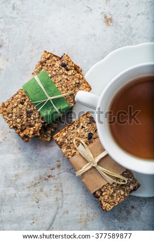 Cup of tea and granola bars - stock photo
