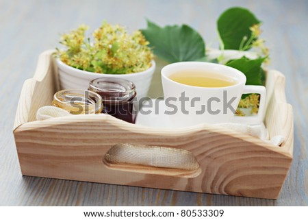cup of tea and linden flowers - tea time - stock photo