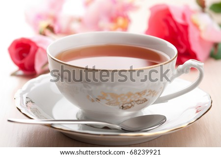 cup of tea and roses - stock photo