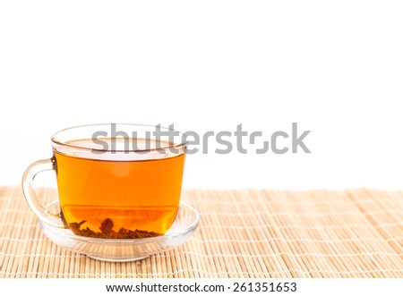 cup of tea and saucer on wooden background - stock photo