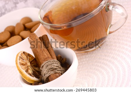 cup of tea (coffee), some cookies and old fruits, cinnamon and lemon - stock photo