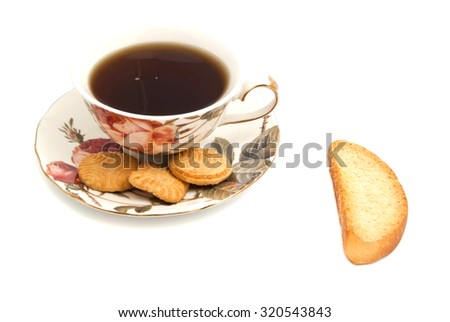 cup of tea, cookies and cracker on white background - stock photo