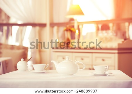 cup of tea is on the table in a luxury restaurant. Interrior - stock photo