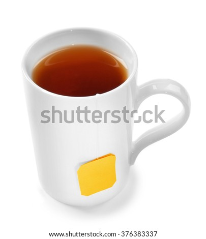 Cup of tea isolated on white background. Teabag with yellow label - stock photo