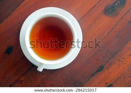 Cup of tea on a wood table, top view - stock photo