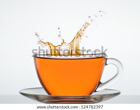 cup of tea on the mirror surface - stock photo