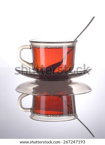 Cup of tea on the reflective surface - stock photo