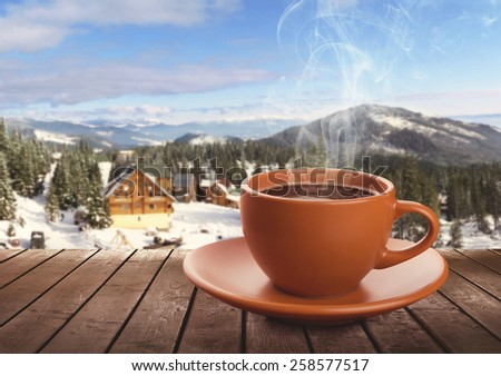 Cup of tea on winter background - stock photo