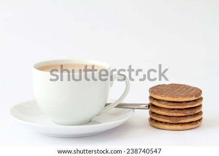 Cup of tea with chocolate biscuits - stock photo