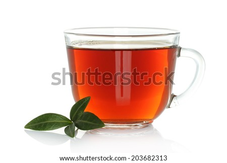 Cup of tea with green leaves on a white background - stock photo