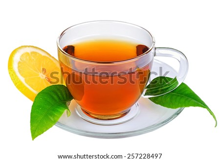 Cup of tea with leaves with lemon. On isolated background. - stock photo