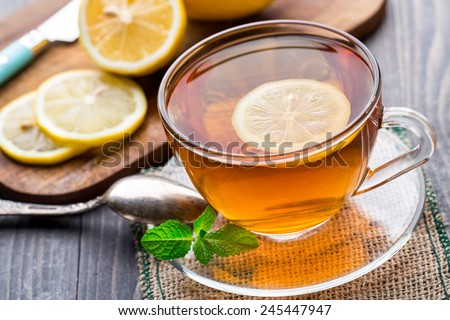 Cup of tea with mint and lemon - stock photo