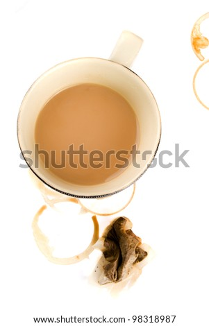 Cup of tea with squashed teabag - stock photo