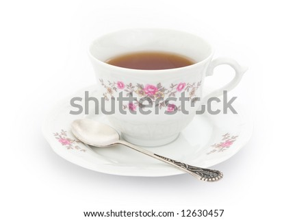 Cup of tea with tea spoon - stock photo