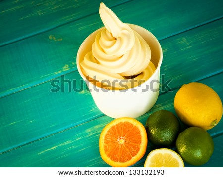 Cup of tropical frozen yogurt with fresh fruit. - stock photo