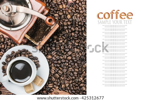 cup of warm coffee and coffee grinder on a wooden table. text example - stock photo