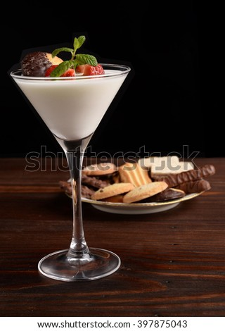 Cup of yogurt and strawberry with chocolate dessert on the table - stock photo