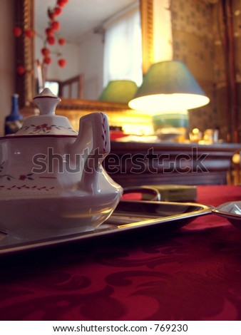 Cup on plate light tamised - stock photo