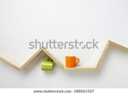 cup on wooden shelf - stock photo