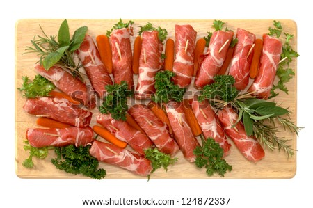 Cup slices pork on wooden board - stock photo