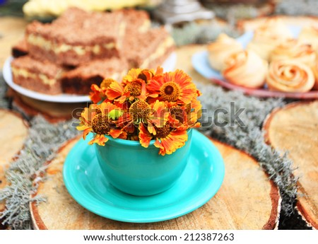cup  tea and fresh flowers - stock photo