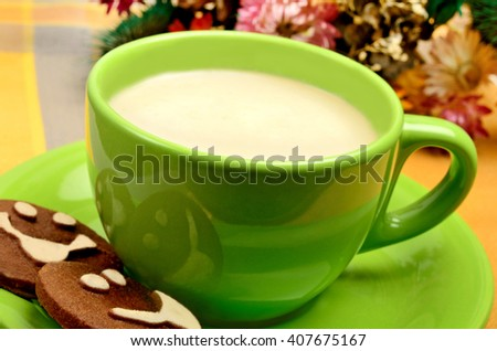 Cup with cappuccino and biscuits on table - stock photo