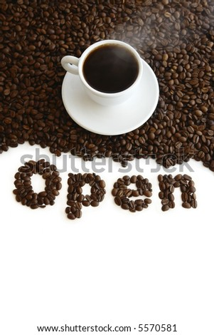 "Cup with coffee, costing on coffee grain, and inscription ""?pen"" from coffee, on white background. - stock photo"