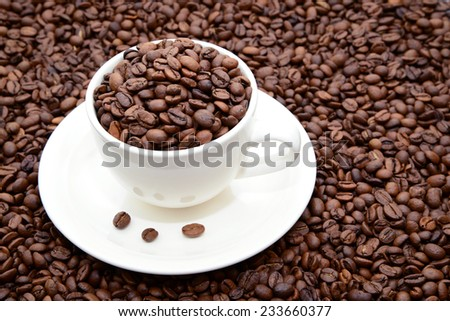 cup with coffee grains on a saucer  - stock photo