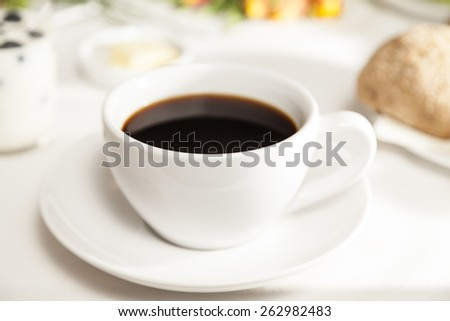 cup with coffee on breakfast table - stock photo
