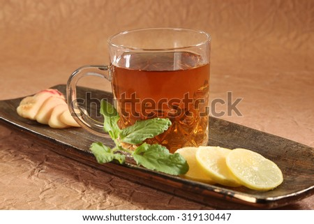 Cup with green tea and leaves & Ginger - stock photo