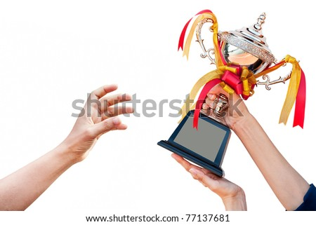 cup with ribbon isolated in hand - stock photo