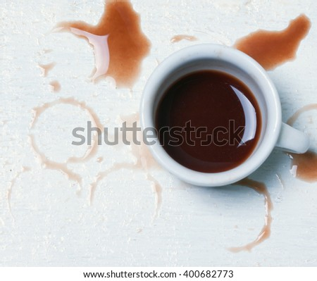 cup with spilled coffee.toned  - stock photo